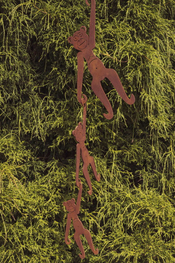Hanging monkeys garden sculpture in rust